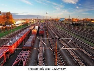 Train freight station - Cargo transportation at sunset