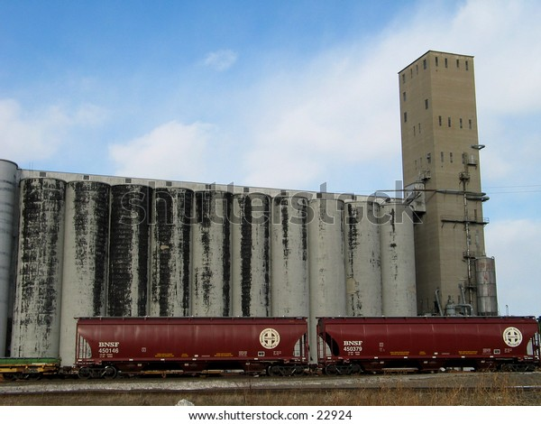 Train in front of grain storage.