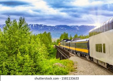 Train going on a railroad track to Denali National Park Alaska