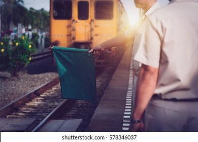 train guard signaling for train to depart