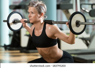 Train Hard Feel Good - Beautiful Fit Woman Doing Barbell Squats In The Gym
