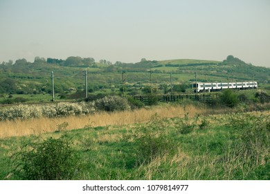 train heading from London to Southend via English countryside