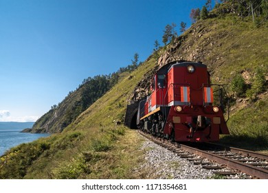 The train leaves the tunnel on the Circum-Baikal Railway