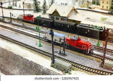 Train models and railroad tracks with winter scenery