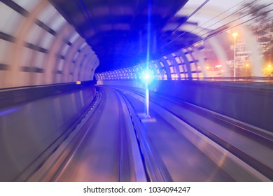 train moving in city rail tunnel with moderate motion blur