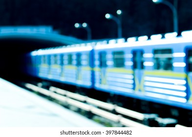 train moving at subway station. Blurred background