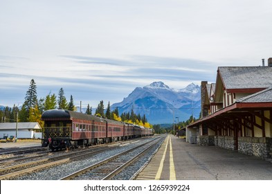 Train of old type staying at Banff Station with autumn leaves and Cascade Mountain in Autumn, Banff National Park, Canadian Rockies, Alberta, Canada