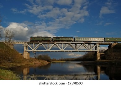 Train on the bridge over river Luga, Novgorodskaya region, Russia
