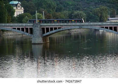Train On a  Bridge over the Vlatava river in early morning ,  Prague, Czech Republic