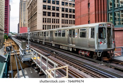 Train on elevated tracks within buildings at the Loop, Chicago City Center - Chicago, Illinois, USA