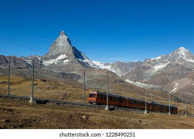 A train on the Gornergrat bahn in front of the famous Matterhorn. Zermatt, Switzerland.
