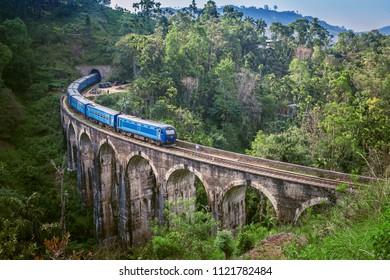 Train on Nine arch Bridge in Sri Lanka. Beautiful train track in hill country. Old bridge in Ceylon