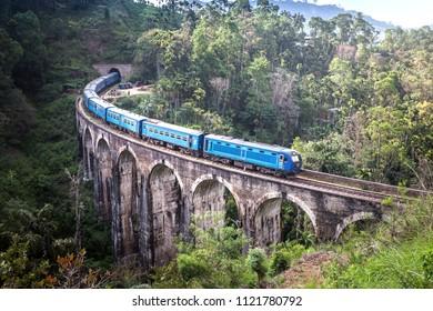 Train on the Nine Arches Demodara Bridge or the Bridge in the sky. Nine Arches Bridge is located in Demodara near Ella city, Sri Lanka