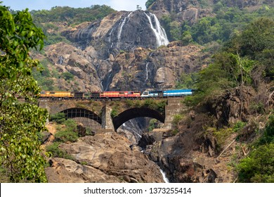 Train on the railway bridge on the background of the Dudhsagar Falls