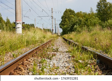 A train on a train track with trees in the background