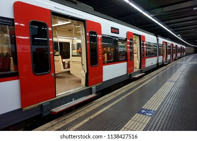 A train with open doors waiting for passengers at the railway station.