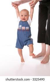 train overalls walking toddler mom
