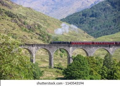 Train passes Glenfinnan Viaduct in Scotland