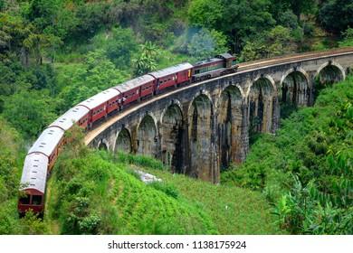 Train passing arched bridge in Ella, Sri Lanka. Nine arches bridge in Ella. Green landscapes around train