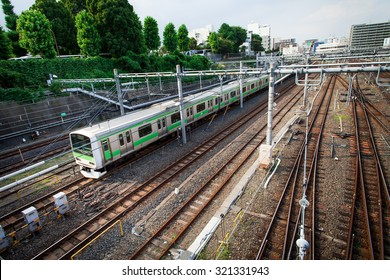 Train passing by on railways in Central Tokyo.