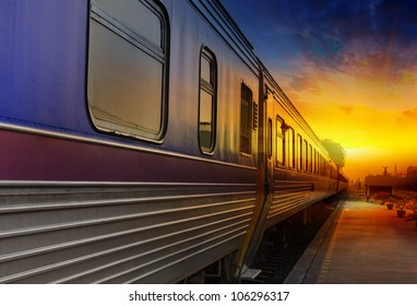 Train passing by in orange sunset
