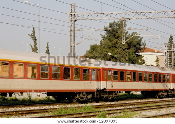 Train passing from a station in Greece
