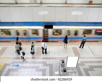 Train passing subway station