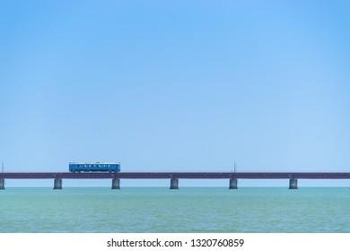 Train passing through the bridge, kyoto, japan