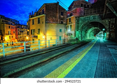 Train platform and a tunnel in Vernazza village, Italy