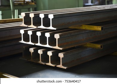 Train rail steel in the factory showing the cross section , tee rail, flat bottom rail