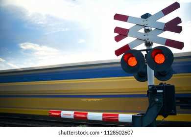 Train railroad crossing with passing high speed riding train