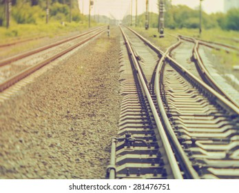 Train railroad disappearing in the distance. Soft focus. Retro style photo.