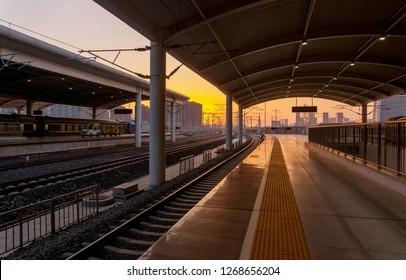 Train At Railway Station, Sunset Orange Light