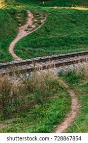 Train railways with walking footpath over rails