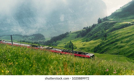A train returns from the top of Europe (Jungfraujoch) on a misty day in the Berner Oberland region of Switzerland.