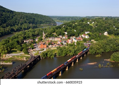 A train rolls across the Shenandoah River in an aerial view of the town of Harpers Ferry, West Virginia, which includes Harpers Ferry National Historical Park.