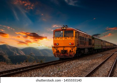 The train is running to the destination station when the sun is going down in the evening in a beautiful natural way in Thailand.