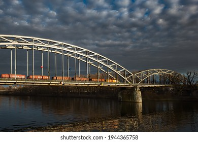 train running over a steel bridge in frankfurt in Germany under dramatic sky