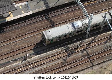 Train running through station in Japan