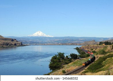 train at scenic Columbia River Gorge with visible Mt. Hood
