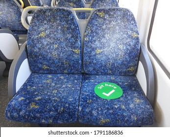 Train seats in Sydney, Australia. Sit Here sign to be safe from coronavirus. It is one of the preventive measure on transportation service in Australia.