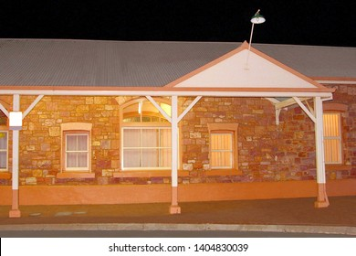 Train station building of Kalgoorlie at night and stop of Indian Pacific train on Nullarbor Plain, Western Australia