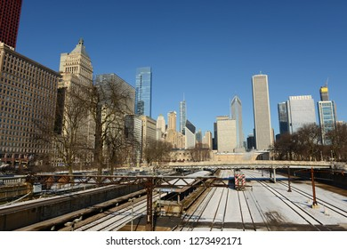Train Station in Chicago, USA with tall buildings on background