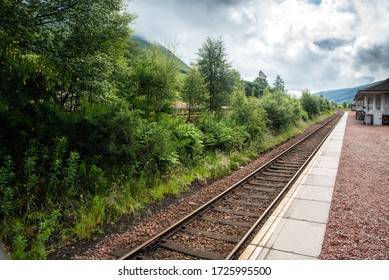 Train station with empty railway train lines. Bridge of orchy, Highlands of Scotland , United kingdom