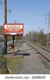 Train station outside Portland Oregon. With bike trail running along the railroad tracks.