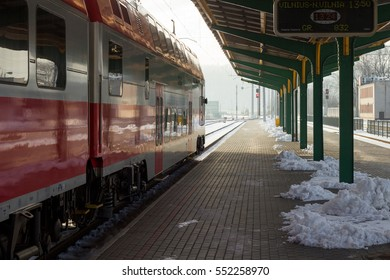 Train station in winter. Temperature -20°C. Train is leaving