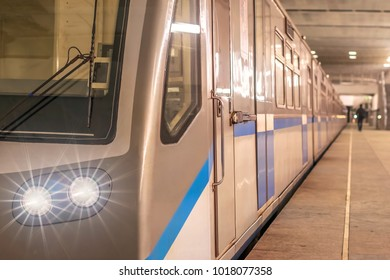 train subway underground with glowing lights luminous headlights and beams included from the front the whole length of the station platform tube