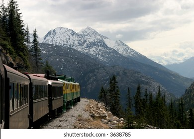 A train takes tourists through the Canadian Rockies and Alaska.