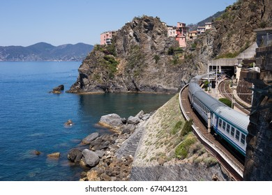 Train temporarily stopped at the Manarolo village on its way through Cinque Terre on Italy's riviera.