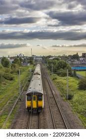 Train towards london with london skyline in background/Train to london/London transport